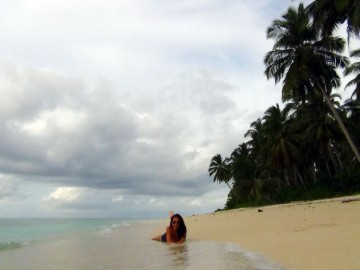 Laura on one of the endless beaches of Tando Island