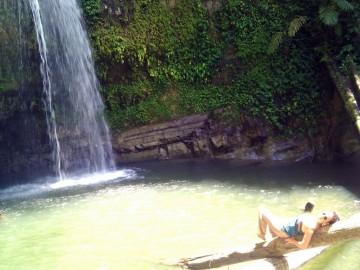 Laura in a secret waterfall in Tando Island
