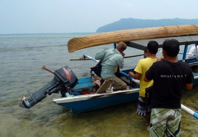 Loading the boat on the way to Siroktabe. You can find the canoe for his experience above the boat