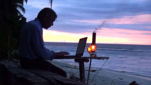 French working from a desert island