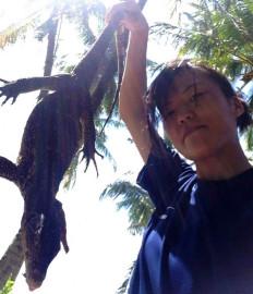 Reikko Hori holding monitor lizard survival