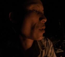 Ho Van Lang looking at the fire at night time