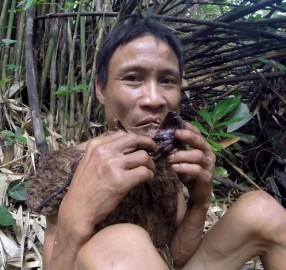 Ho Van Lang eating a rat