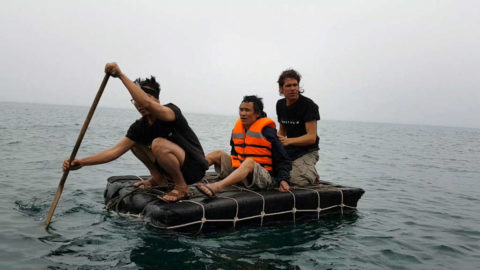 Ho Van Lang (the real life Tarzan) carried by Alvaro Cerezo on a floating rubber device